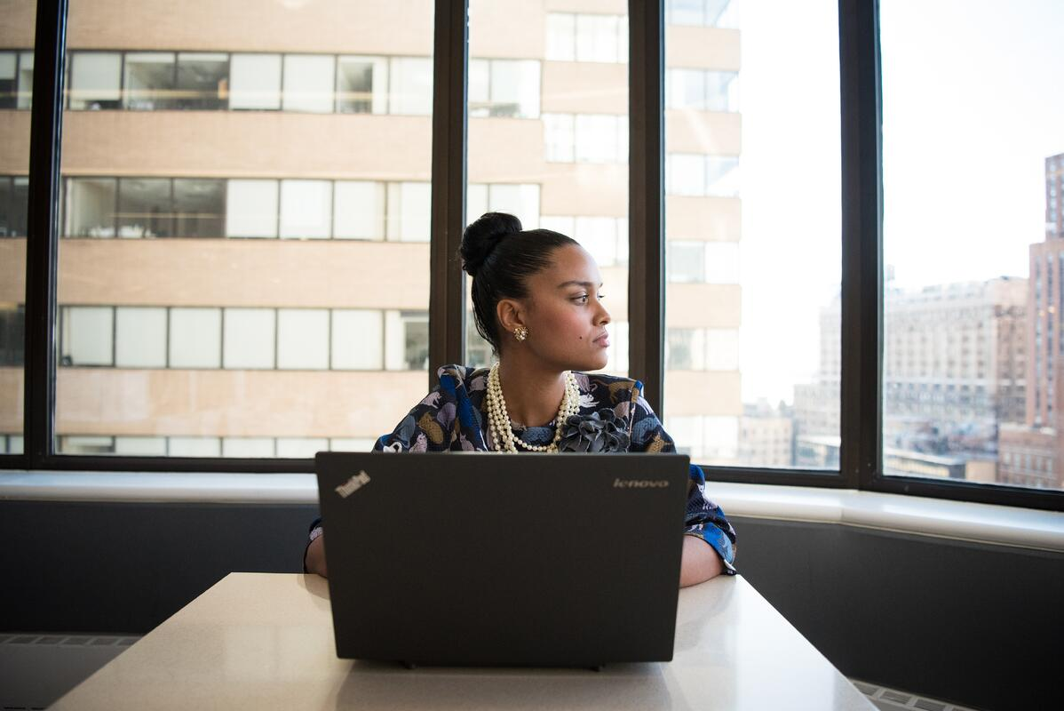 Canva - Woman Sits in Front of Black Laptop Computer